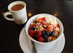 Crème brûlée oatmeal: Topped with whipped cream, almond slivers, and fresh berries